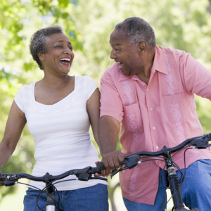 couple on bicycles smiling at each other