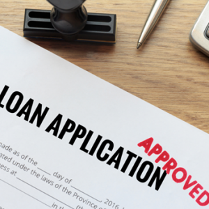 approved loan application on desk
