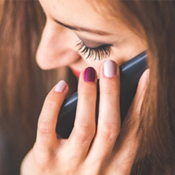 closeup photo of a woman using her cell phone