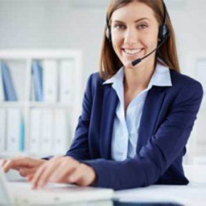 telephone representative answer a phone call using a headset and computer